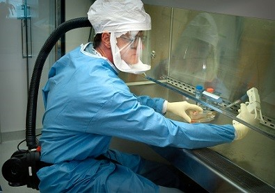 researcher working with ppe on samples